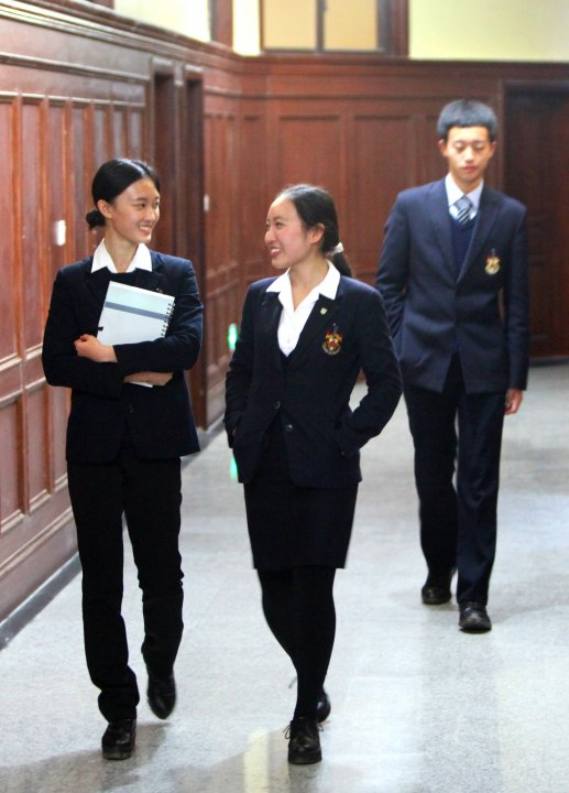 Three Chinese students in the school corridor
